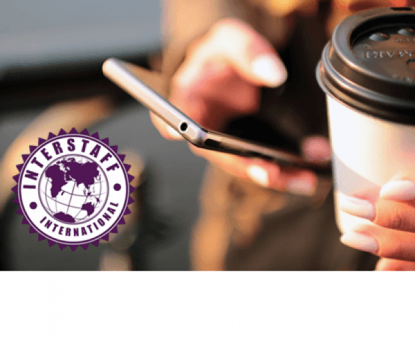 Woman holding her mobile phone and coffee cup with Interstaff International logo