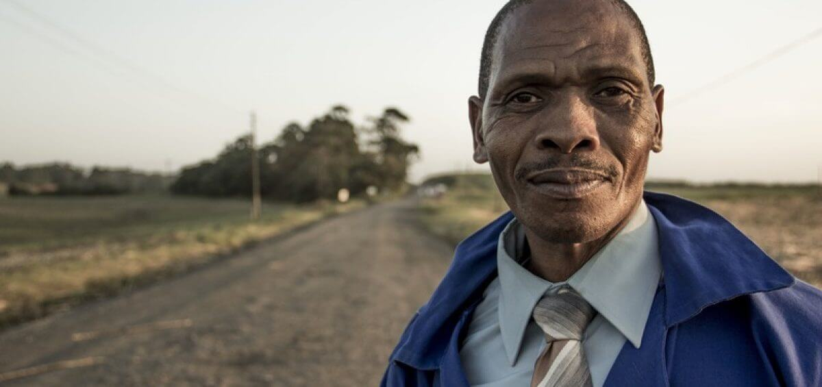 Closeup of ethnic man standing on road