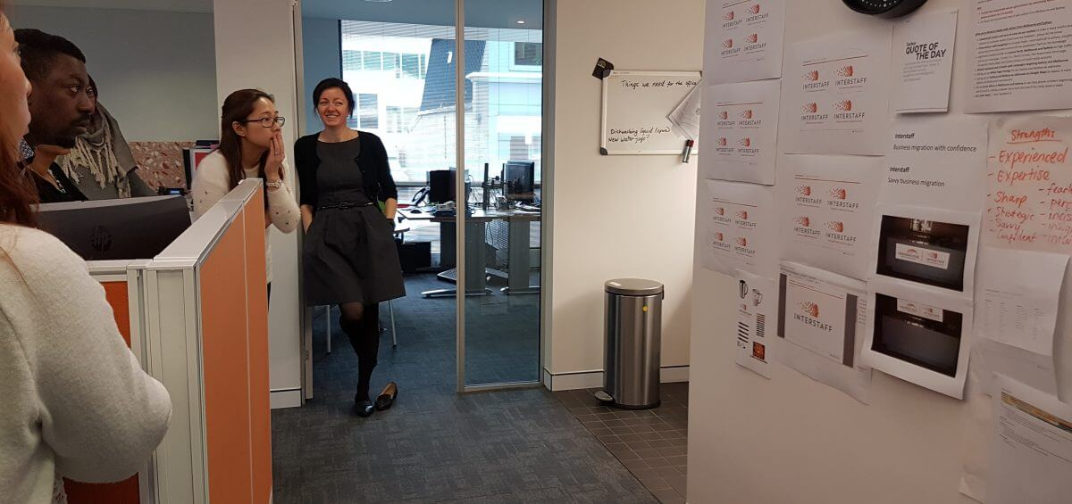Sheila Woods smiling at the Interstaff team in the HQs