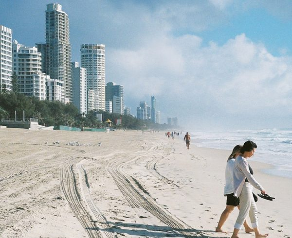 Two woman walking down Surfer's Paradise in Queensland