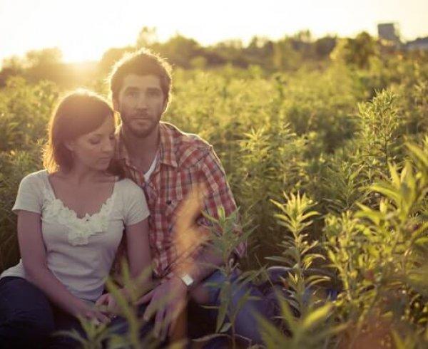 Couple posing in a regional field