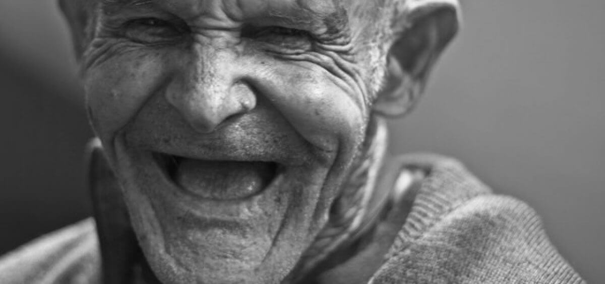 An elderly man full of happiness