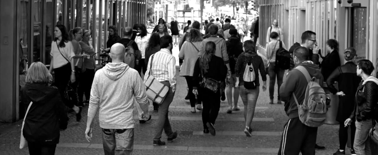 People walking through a city street