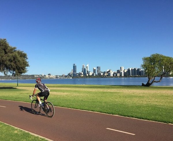Man cycling in Perth, one of the top 10 most liveable cities