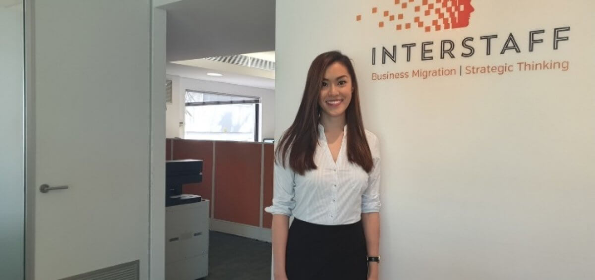 Registered migration agent (MARN: 1808239) Melissa Phan standing in the Interstaff office