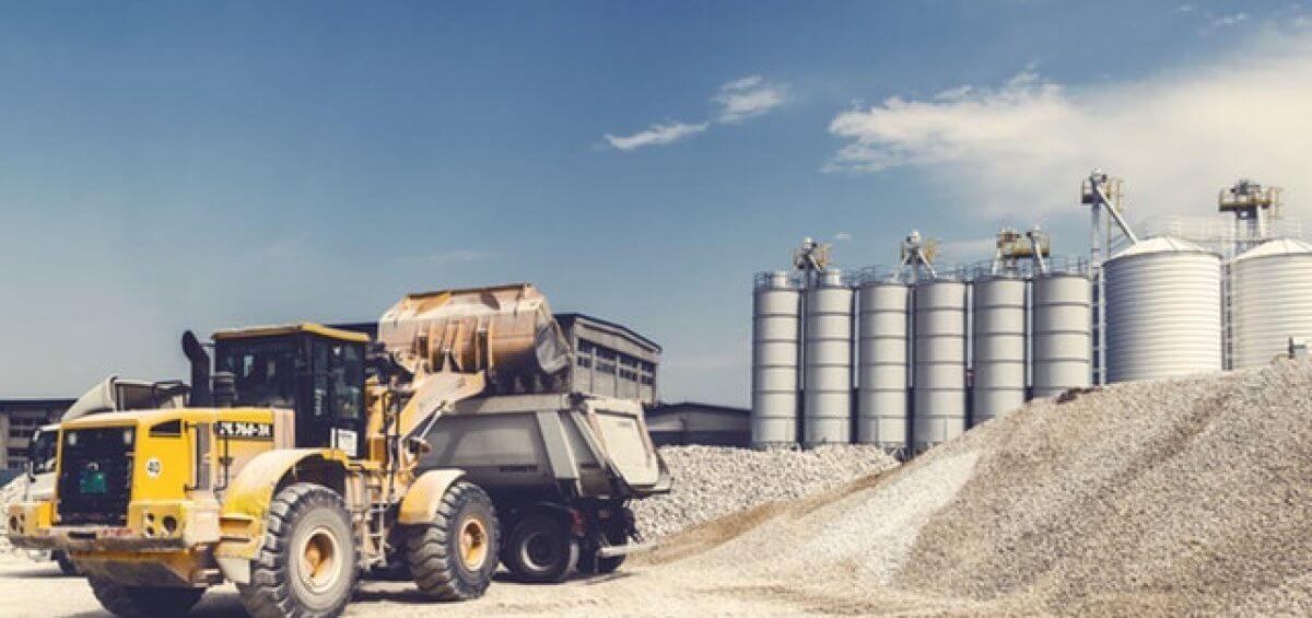 Yellow heavy equipment track on mite site