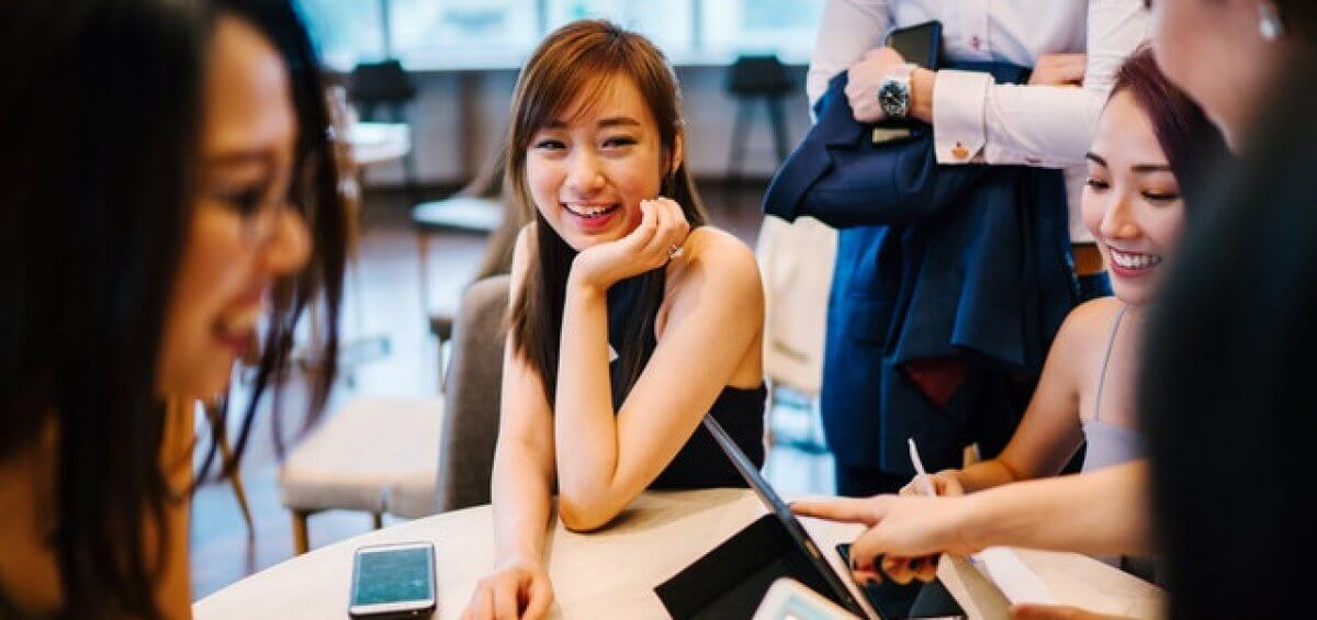 Group of young Asian adults enjoying a workplace conversation for 5 Australia visa changes to expect in 2019
