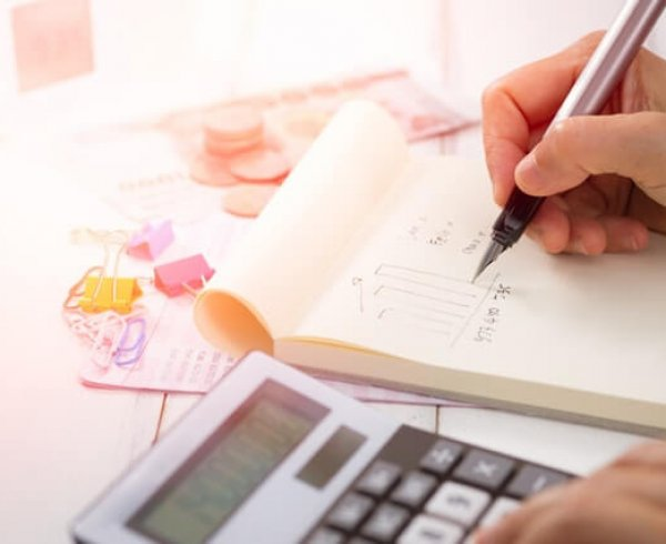 Person calculating finances during the 2019 Federal Budget