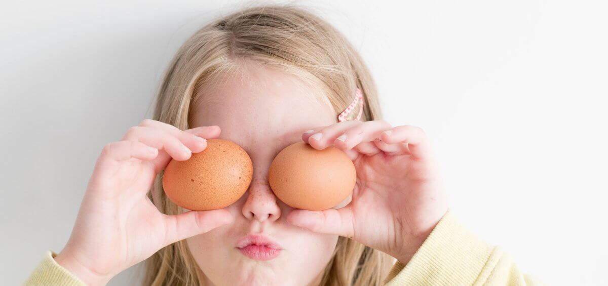 Young girl with two eggs over her eyes for Easter Perth celebrations