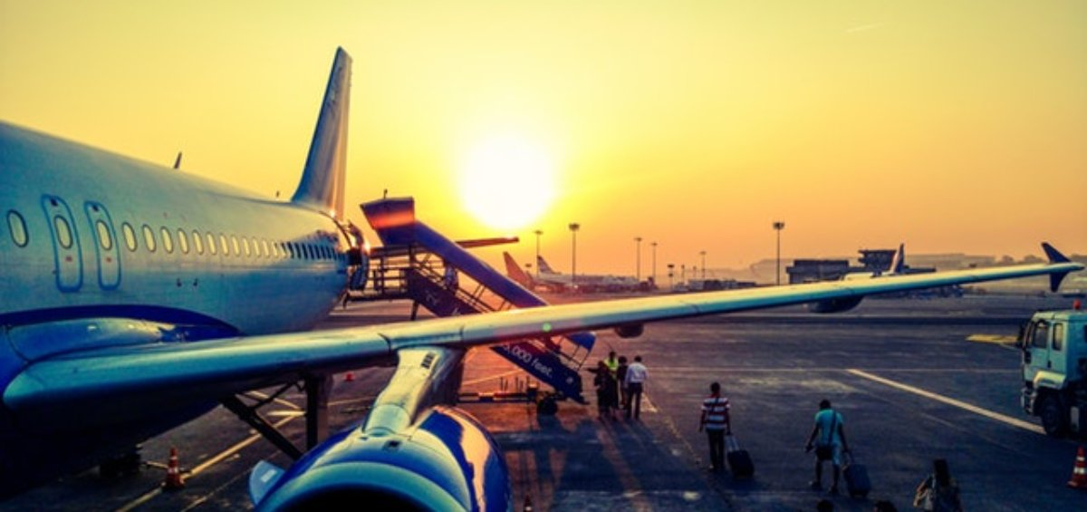 Individuals coming onto airplane as Coronavirus travel ban updates for Korea and Italy