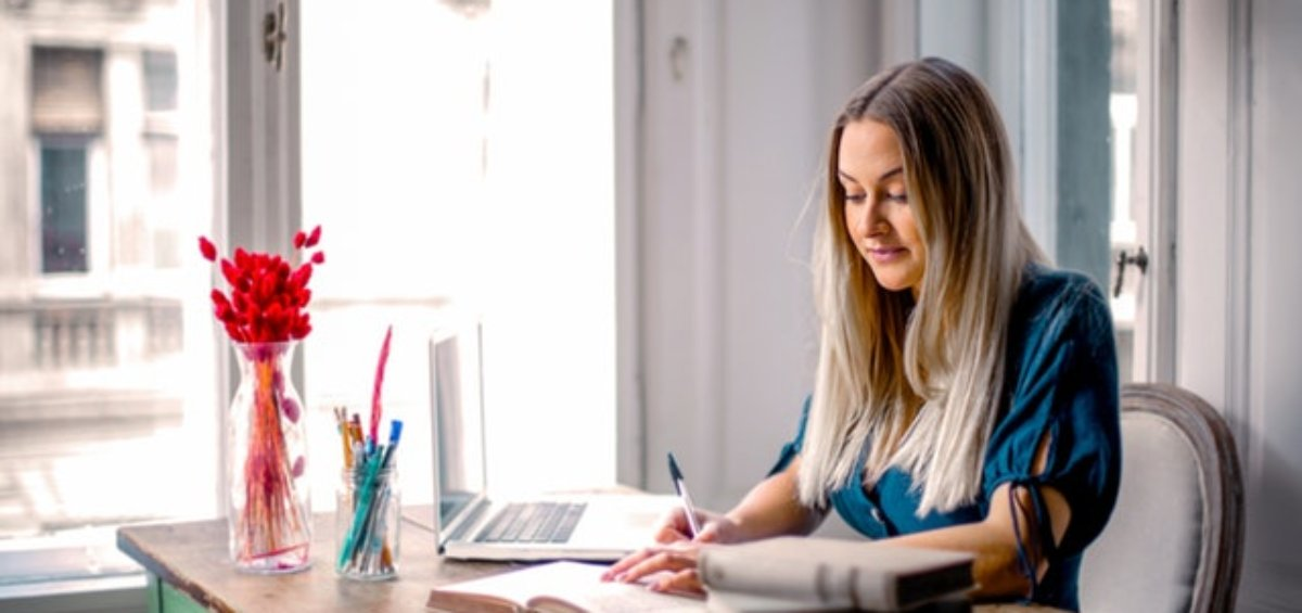 Woman at desk researching support for temporary visa holders in Australia