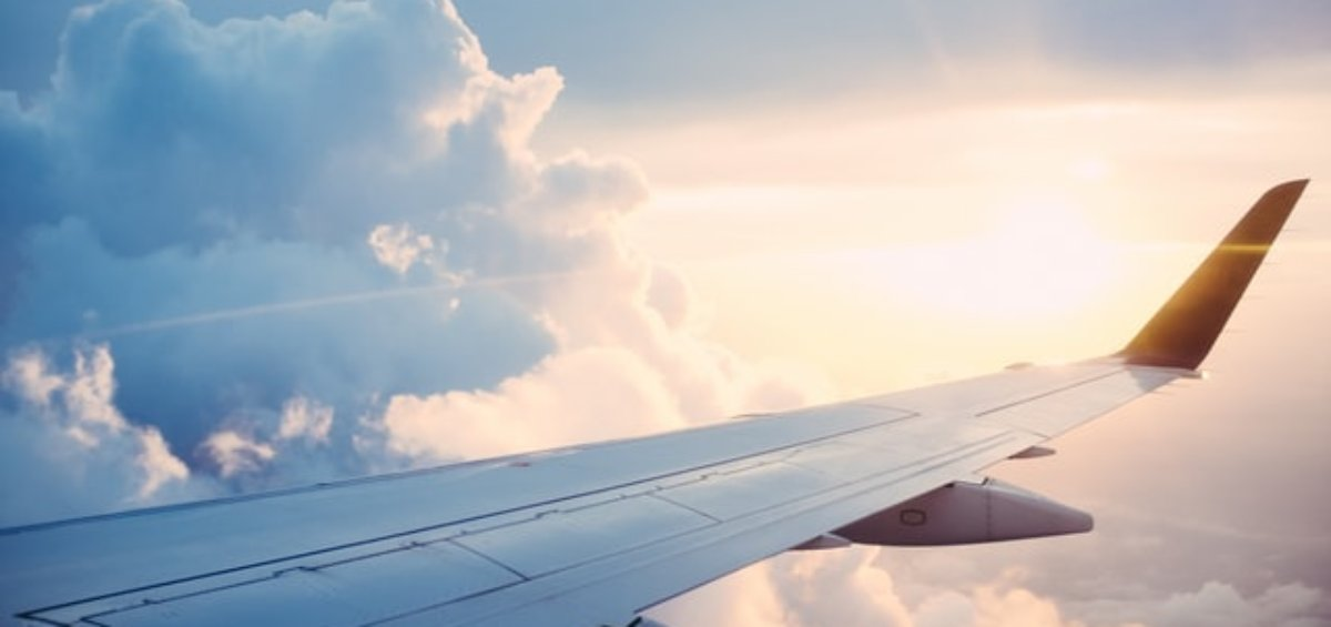 Airplane in the sky for Australian visa processing COVID-19